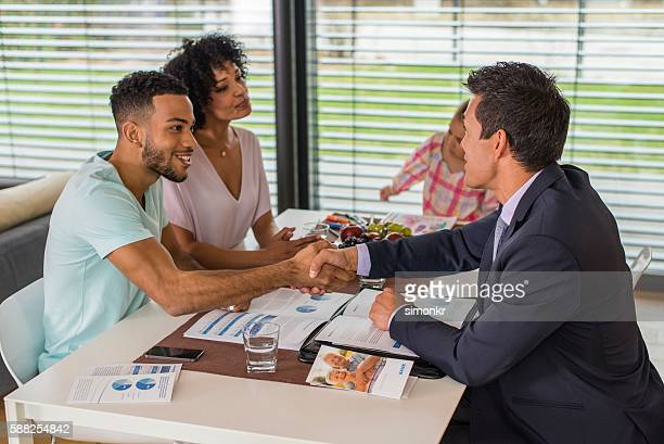 Man greeting male financial advisor