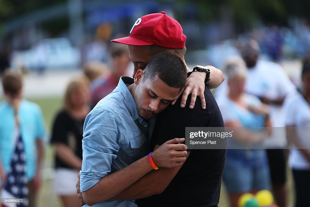 A man grieves for a friend at a memorial at the Performing Arts Center which is down the road from the Pulse nightclub on June 17, 2016 in Orlando, Florida. In what appears to be partly an ISIS inspired attack, Omar Mir Seddique Mateen killed 49 people at the popular gay nightclub early Sunday. Fifty-three people were wounded in the attack which authorities and community leaders are still trying to come to terms with.