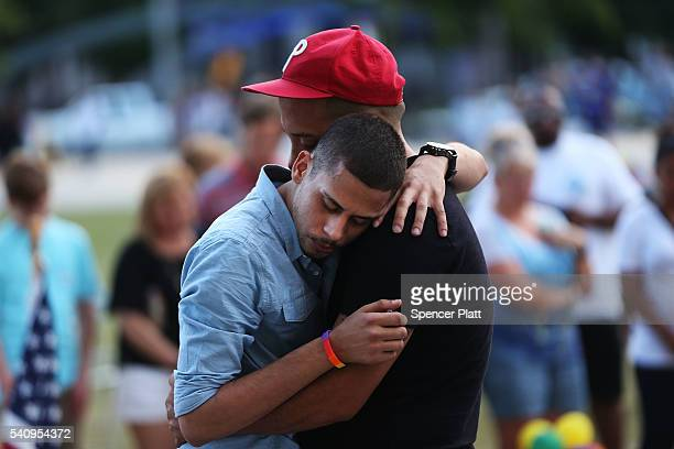 A man grieves for a friend at a memorial at the Performing Arts Center which is down the road from the Pulse nightclub on June 17 2016 in Orlando...