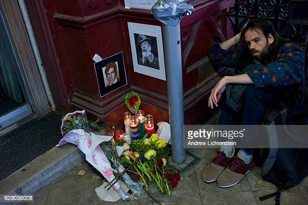 Man grieves next to a small memorial outside of New York's famous Chelsea Hotel in memory of the musician and songwriter Leonard Cohen on November...