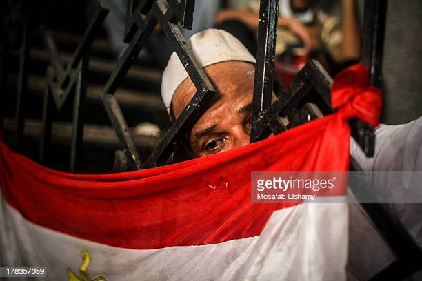 CONTENT] A man grieves next to an Egyptian flag after Egyptian security forces stormed two huge protest camps at the Rabaa alAdawiya and AlNahda...