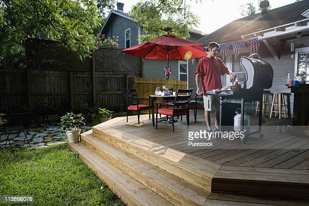 Man grilling on backyard patio on 4th of July