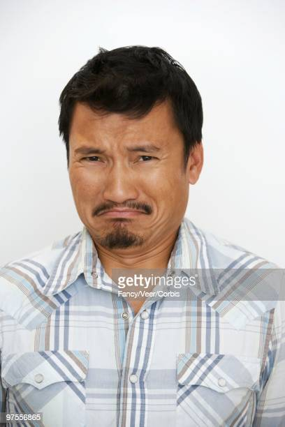 man grimacing - ugly mexican people stock pictures, royalty-free photos & images