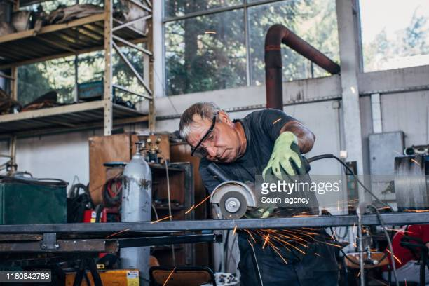 man grinding - work glove stock pictures, royalty-free photos & images