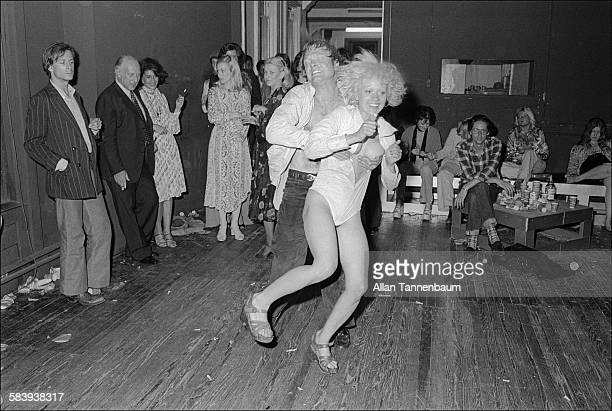 A man grips his female partner's breasts as they dance at the wake for Warhol Superstar Eric Emerson New York New York June 16 1975 Emerson had been...