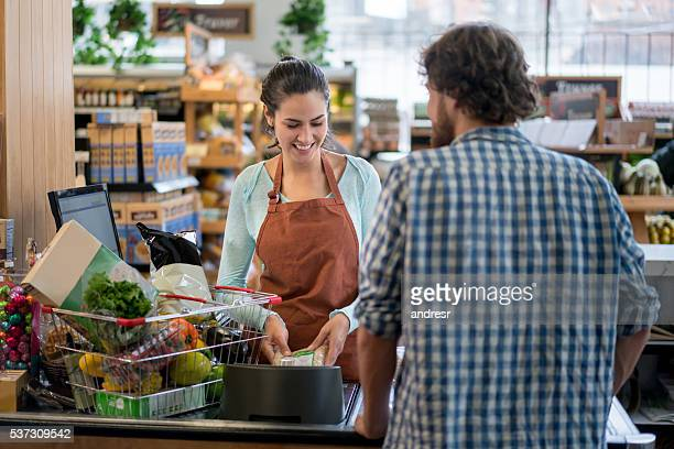 man grocery shopping at the supermarket - cashier stock pictures, royalty-free photos & images