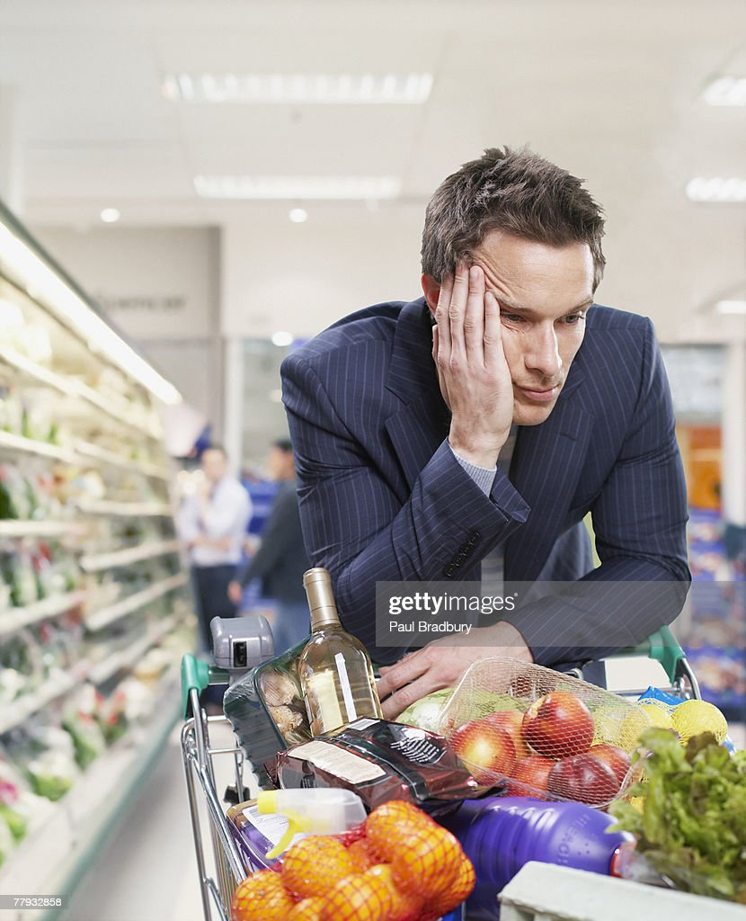 Man grocery shopping : Stock Photo