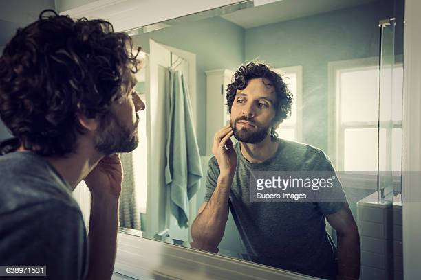 man grooming in bathroom - beard stock pictures, royalty-free photos & images