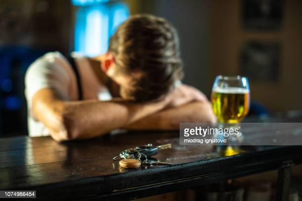 man had too much drinks - ubriaco foto e immagini stock