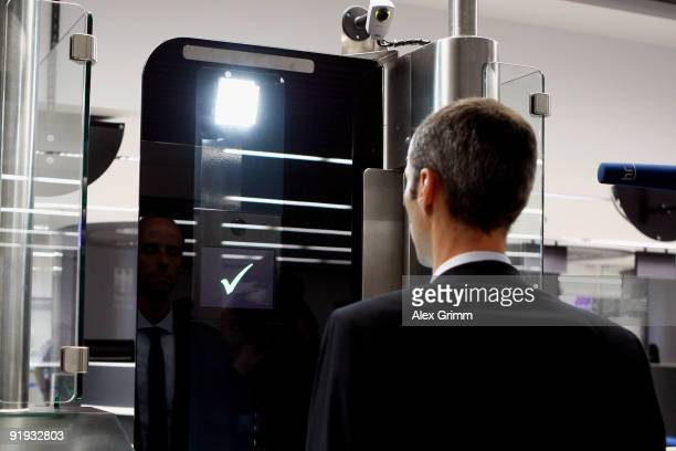 A man halts in front of a camera during the presentation of the new automated border control system easyPass at Frankfurt International Airport on...