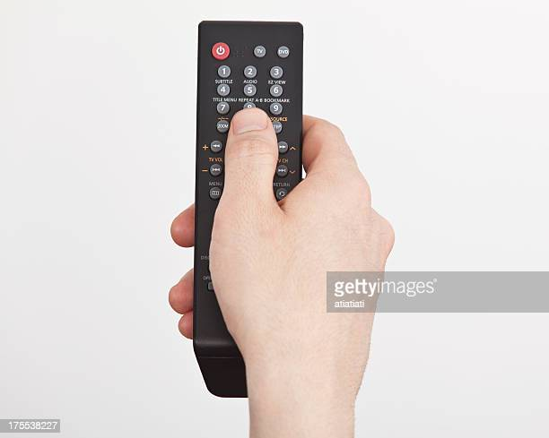 man hand holding remote control