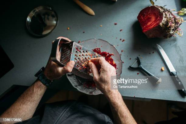 man hand scratching beet - focus on foreground stock pictures, royalty-free photos & images