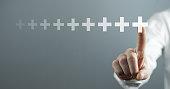 Man hand touching plus sign. Positive, Benefit, Development