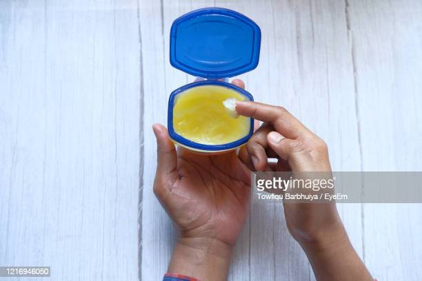 man hand use vaseline - vaseline stock pictures, royalty-free photos & images