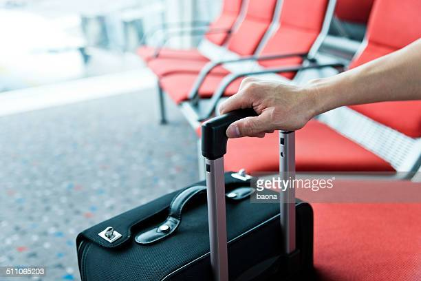 man hand with suitcase
