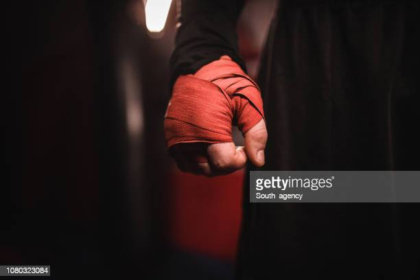 man hand wrapped in boxing bandages - mixed martial arts stock pictures, royalty-free photos & images