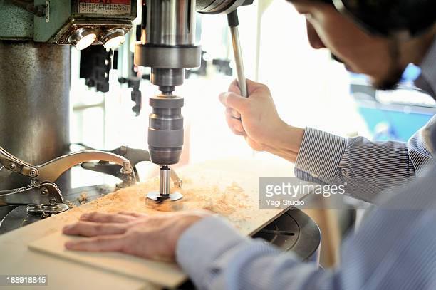 Man handcrafting furniture in workshop