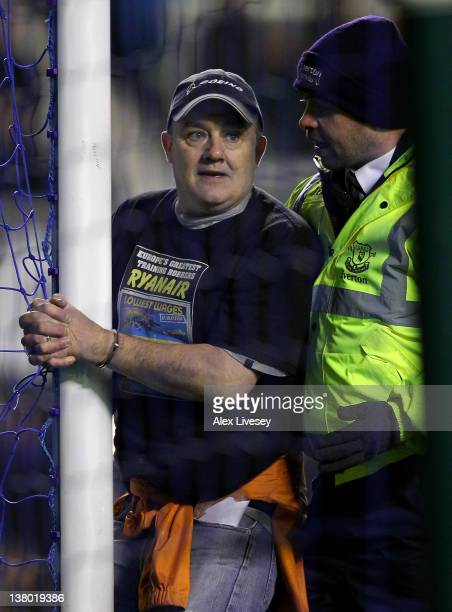 Man handcuffs himself to the goal posts during the Barclays Premier League match between Everton and Manchester City at Goodison Park on January 31,...