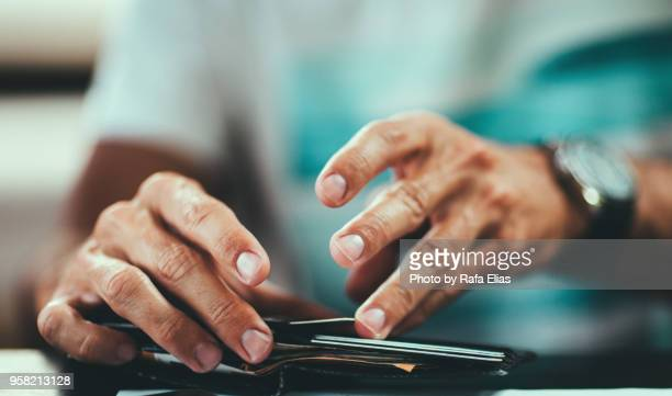 man hands on wallet - greeting card bildbanksfoton och bilder