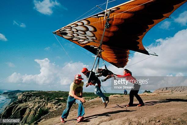 Man Hang-gliding With His Dog