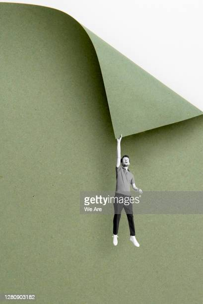 man hanging from cliff - reaching stock pictures, royalty-free photos & images