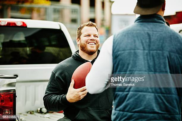 man hanging out during tailgating party - tailgate party stock pictures, royalty-free photos & images
