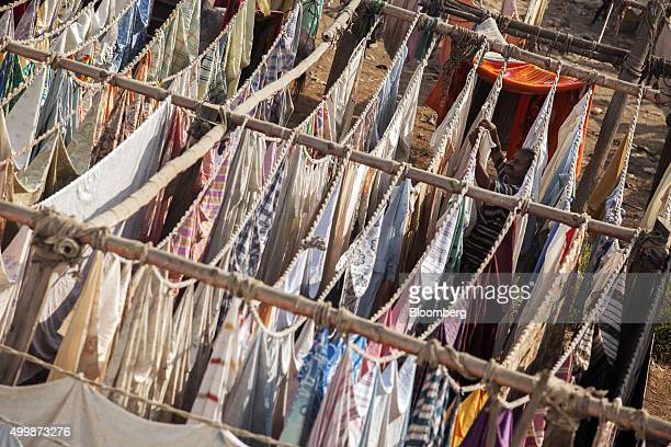 A man hangs cloths to dry at an open air laundry facility known as the Dhobi Ghat in Karachi Pakistan on Wednesday Dec 2 2015 A committee of...