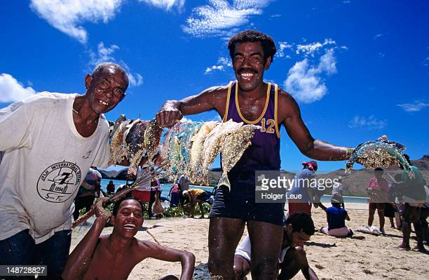 Man happy with their catch of the day.