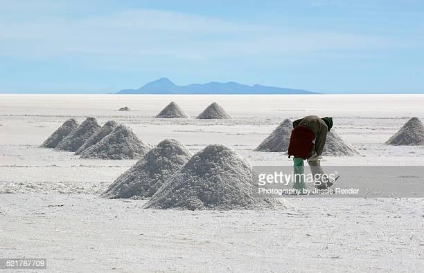 Man harvesting salt at Salar de Uyuni salt flat