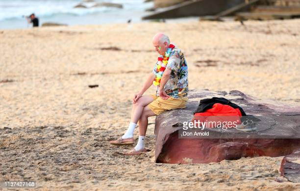 A man has a moment of quiet reflection at Bondi Beach on March 22 2019 in Sydney Australia Surfers gather to celebrate five years of OneWave a not...