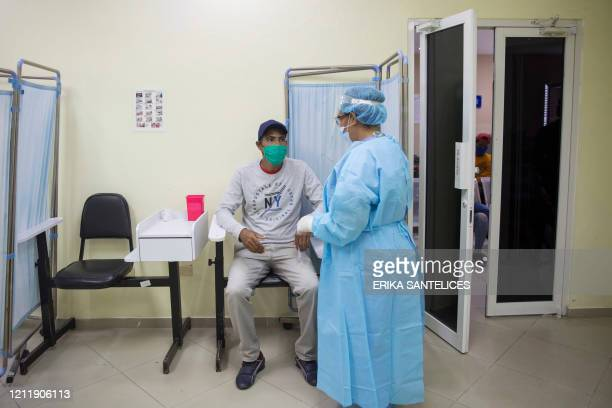 Man has a rapid test for COVID-19 at the Regional University Hospital Doctor Luis Manuel Morillo King in La Vega, in the Dominican Republic, on May...