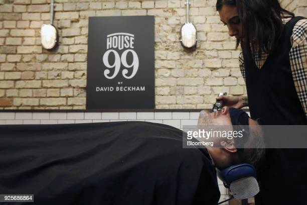 Man has his beard groomed during a launch event for House 99, a grooming brand for men created by former soccer star David Beckham and L'Oreal SA, in...