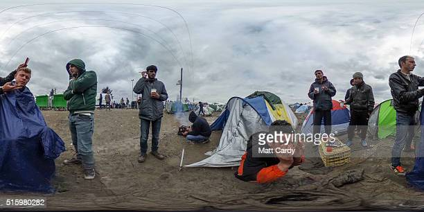 A man has his hair cut at the Idomeni refugee camp on the Greek Macedonia border on March 16 2016 in Idomeni Greece The decision by Macedonia to...
