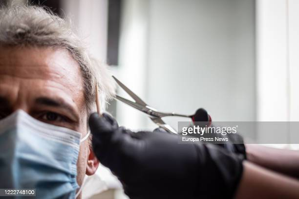 Man has his hair cut in a hairdresser's shop on the day that these premises can be attended by appointment and with limited capacity within the first...