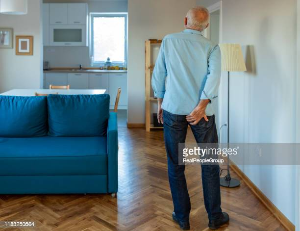 man has pain in the butt. - buttock stock pictures, royalty-free photos & images