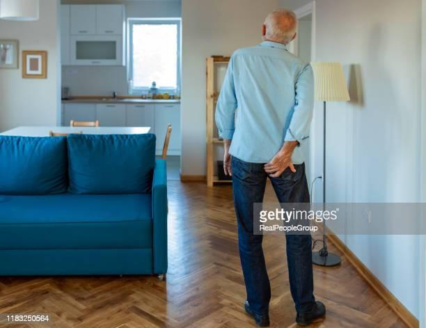 man has pain in the butt. - culi foto e immagini stock