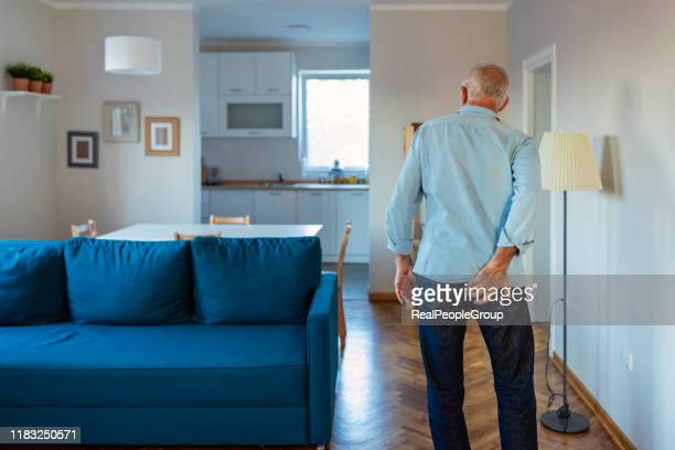 man has pain in the butt. - hemorrhoid stock photos and pictures