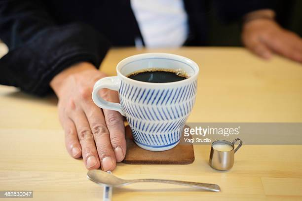 Man has put a drip coffee at the counter