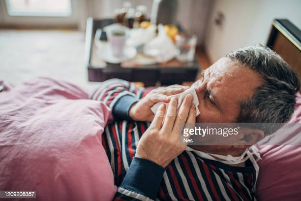 man has symptoms of virus, has sneezing - mucus stock pictures, royalty-free photos & images