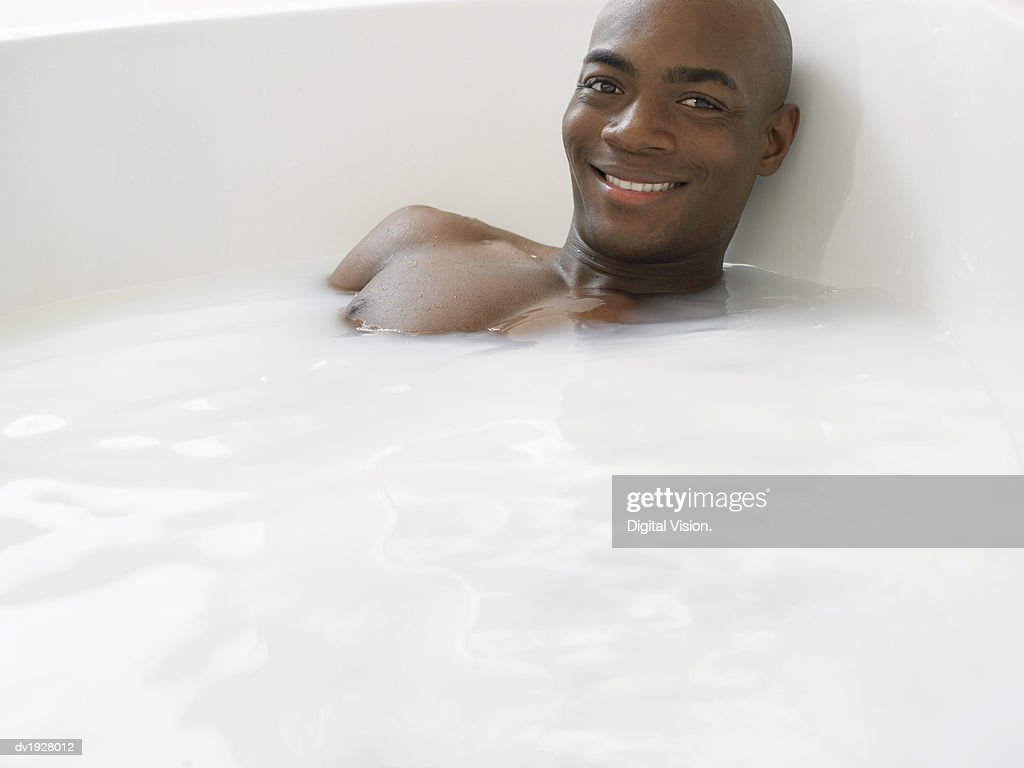 Man Having a Bath : Stock Photo