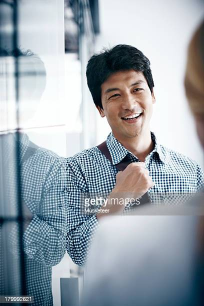 man having a chat in the office - focus on background stock pictures, royalty-free photos & images