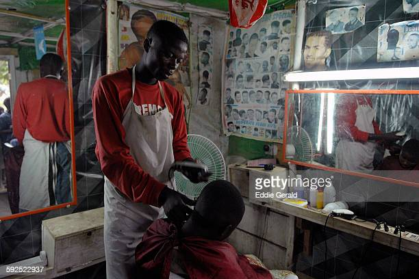 A man having a haircut in a barber shop in a village in North Kivu In Congo DR central Africa