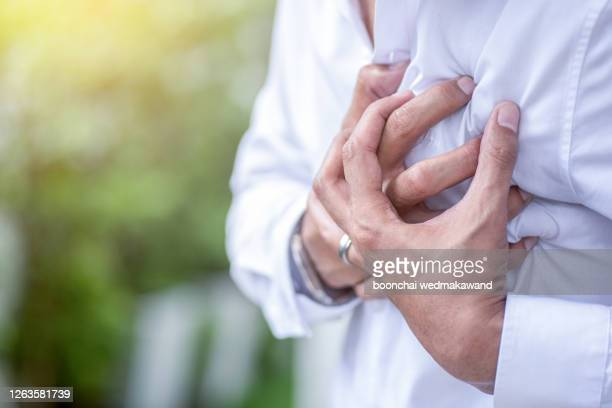 man having a heart attack. - beating heart stock pictures, royalty-free photos & images