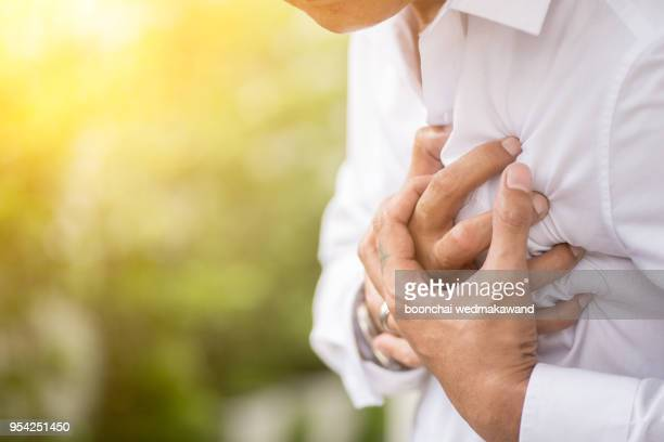 man having a heart attack. - heart disease stock pictures, royalty-free photos & images