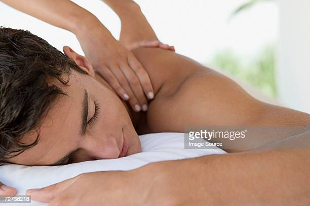 man having a massage - massage stock pictures, royalty-free photos & images