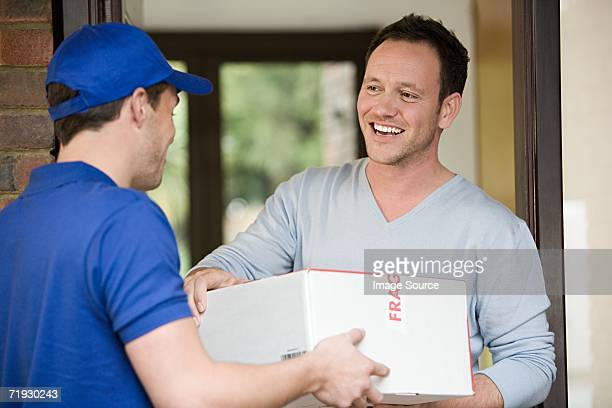 Man having a parcel delivered