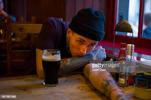 Man having a pint in the pub