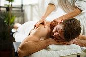 Man having back massage at the health spa.