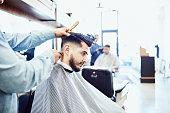 man having back neck trimmed during