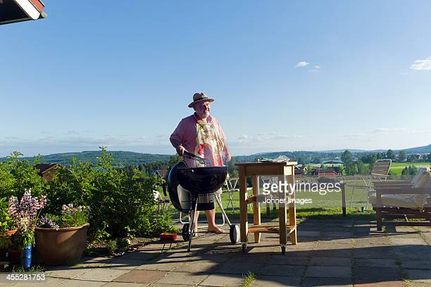 man having barbecue outdoor - funny bbq stock pictures, royalty-free photos & images